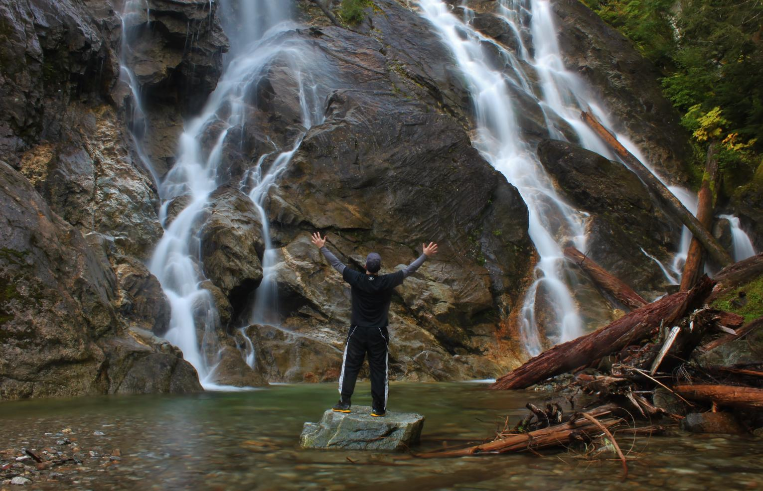 Enjoying the majesty of Lower Cougar Creek Falls
